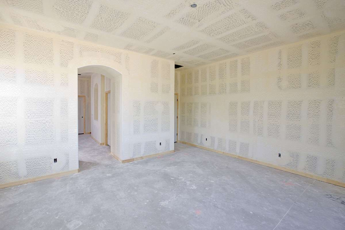 A large room with new drywall